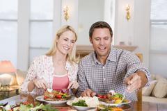 Couple eating meal,mealtime together Stock Photos