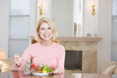 Woman enjoying healthy meal,mealtime Stock Photos