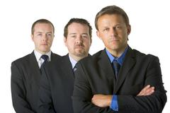 Group Of Businessmen Looking Stern - stock photo