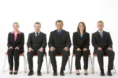Group Of Business People Sitting In A Line Stock Photos