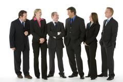 Group Of Business People Standing Around Conversing - stock photo