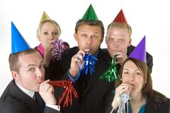 Group Of Business People Wearing Party Favors Stock Photos