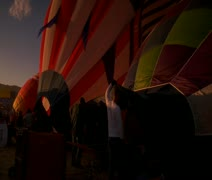 Partially filled  hot air balloons languish on the ground Stock Footage