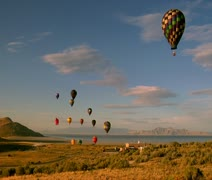 Hot air balloons lifting into the sky shot from basket Stock Footage