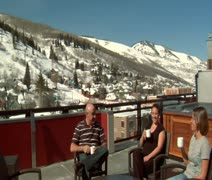 People enjoy sunny  winter weather on the rooftop in Park city Utah the Stock Footage