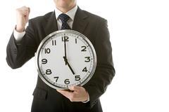 businessman holding clock - stock photo
