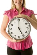 woman holding clock - stock photo