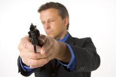 Businessman pointing gun Stock Photos