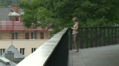 A woman looks at a lookout point Stock Footage