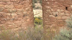 Tilt up shot revealing ruins at  Hovenweep national Monument Stock Footage