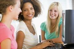 teenage girls using desktop computer - stock photo