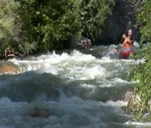 Man navigates white-water rapids in kayak Stock Footage