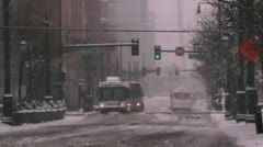 City Street Bus Snowing Stock Footage
