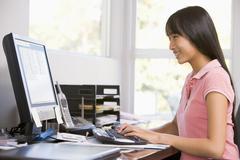 Teenage girl using desktop computer Stock Photos
