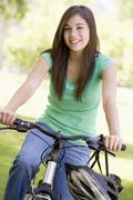 teenage girl on bicycle - stock photo