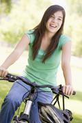 teenage girl on bicycle - stock photo