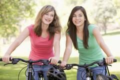 Teenage girls on bicycles Stock Photos