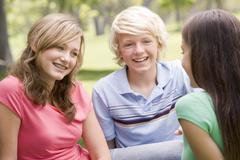 teenagers sitting and conversing - stock photo