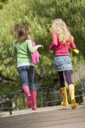 pair of teenage girls jogging in park - stock photo