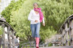 Teenage girl jogging in park Stock Photos
