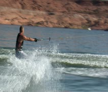 Muscular man jumps  wake on wake board Stock Footage