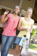 teenage girls out shopping - stock photo