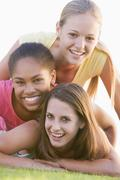 Teenage girls having fun outdoors Stock Photos