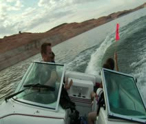 Young people drive ski boat and turns sharply Stock Footage