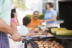 Family enjoying a barbeque Stock Photos
