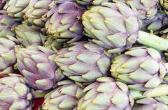 Fresh artichokes at the market Stock Photos