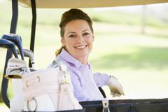 Portrait of woman sitting in a golf cart Stock Photos