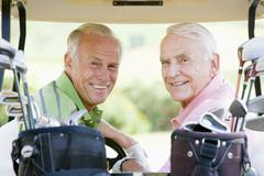 male friends enjoying a game of golf - stock photo