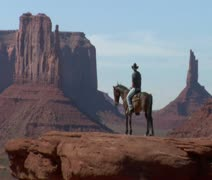 Stock Video Footage of longshot of cowboy and horse in Monument Valley