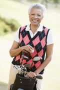 Portrait of a female golfer Stock Photos