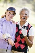 Portrait of two female golfers Stock Photos