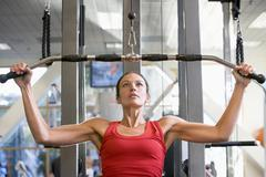 Woman weight training at gym Stock Photos