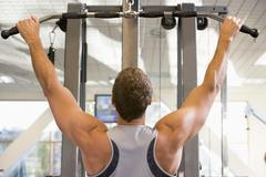 man weight training at gym - stock photo