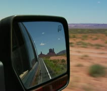 Monument Valley Highway in rearview mirror Stock Footage