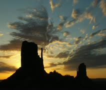 Silhouette of man running with Monument Valley sunrise Stock Footage