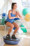 woman using on balance trainer at gym - stock photo