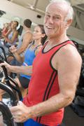 man running on treadmill at gym - stock photo