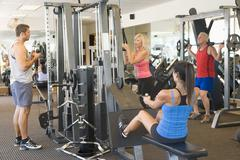 group of people weight training at gym - stock photo