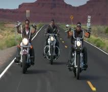 Men on motorcycles ride on Monument Valley highway in Utah - stock footage