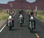 Stock Video Footage of Men on motorcycles ride on Monument Valley highway in Utah