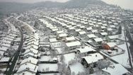Stock Video Footage of AERIAL: Winter flight over suburban houses