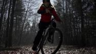 SLOW MOTION: Mountain biker going uphill Stock Footage