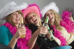 Dressed up teenage girls enjoying drinks Stock Photos