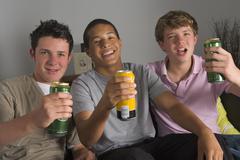 Teenage boys drinking beer Stock Photos