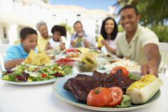Family Eating An Al Fresco Meal - stock photo