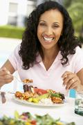 Middle Aged Woman Dining Al Fresco - stock photo